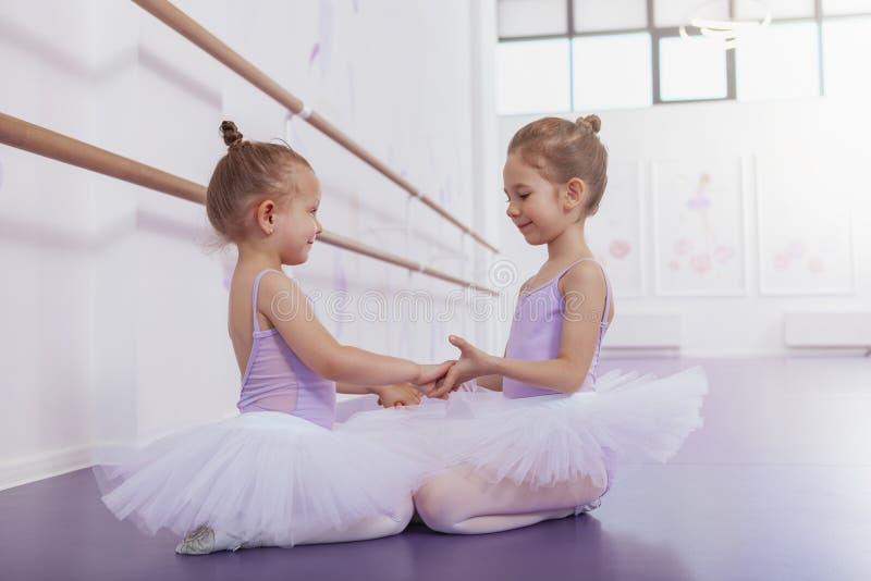 Two adorable little ballerinas at dance class stock photo