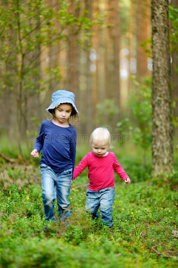 Two adorable little sisters hiking royalty free stock photos