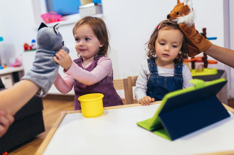 Adorable little sisters playing with a digital tablet at home royalty free stock photo