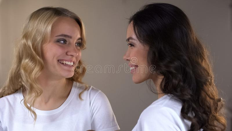 Two adorable women with bright evening make-up ready for party, beauty tips stock photo