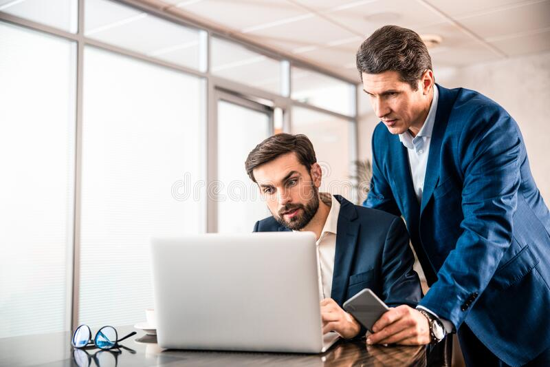 Two adult entrepreneurs working on a project stock photos