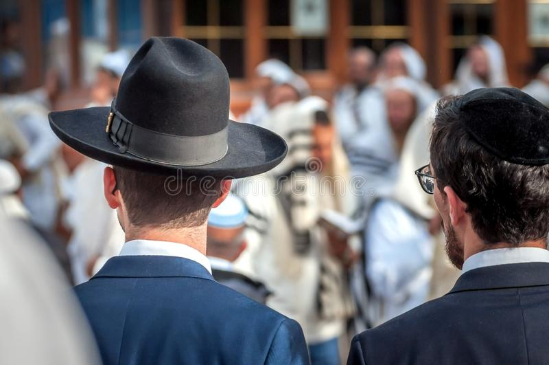 Two adult Hasidim in traditional Jewish headdresses hat and kippah. Prayer of Hasidim royalty free stock photo