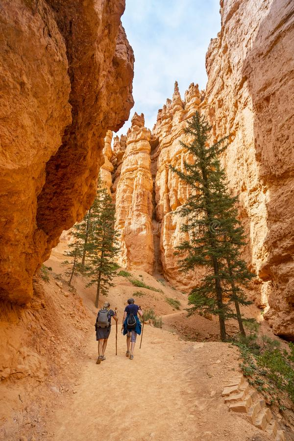 Two adult women hiking in Bryce Canyon National Park, Utah, USA while on vacation. Candid photo, view from behind. On two people on an uphill hike royalty free stock photos