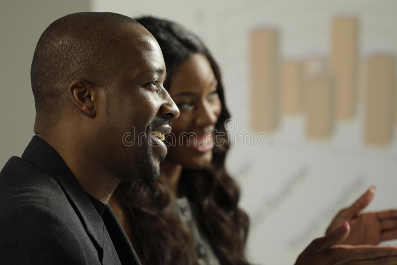 Two African American business man and woman in a meeting stock photos