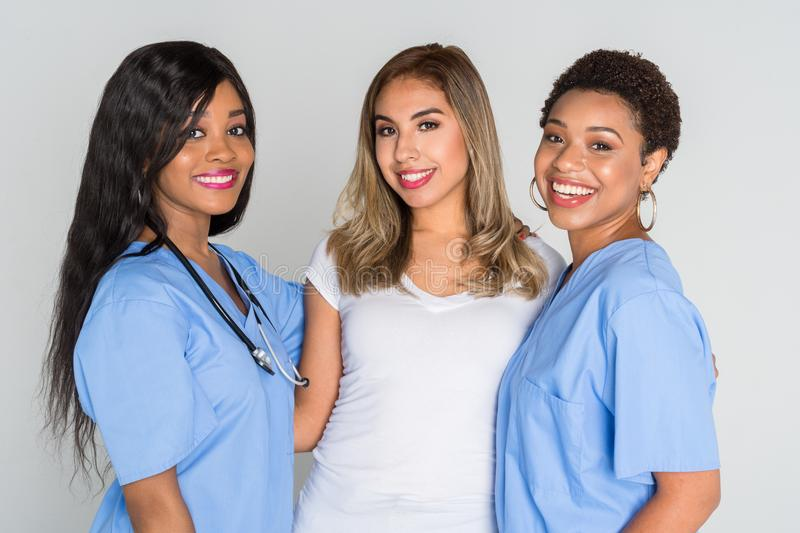 Nurses With A Patient royalty free stock photography