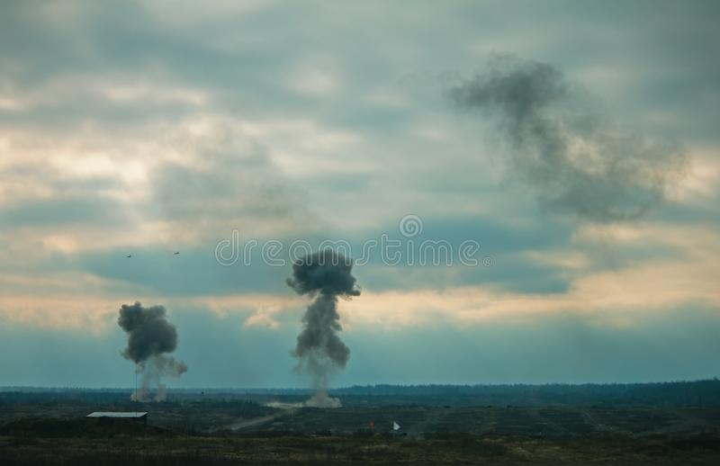 Two air force jets bombing targets at military trainings stock images