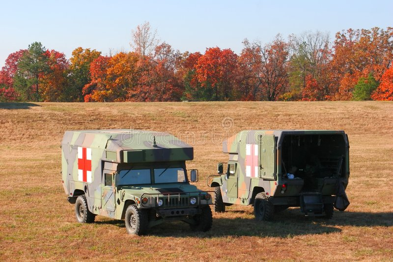 Two ambulances. Two battlefield ambulances parked in the field royalty free stock photo