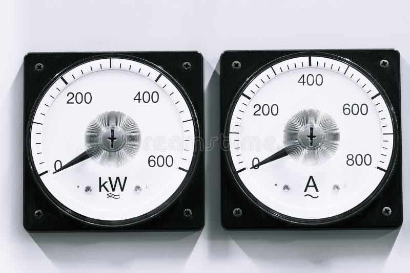 Analog. Two analog voltmeter & amp-meter on lights background stock image