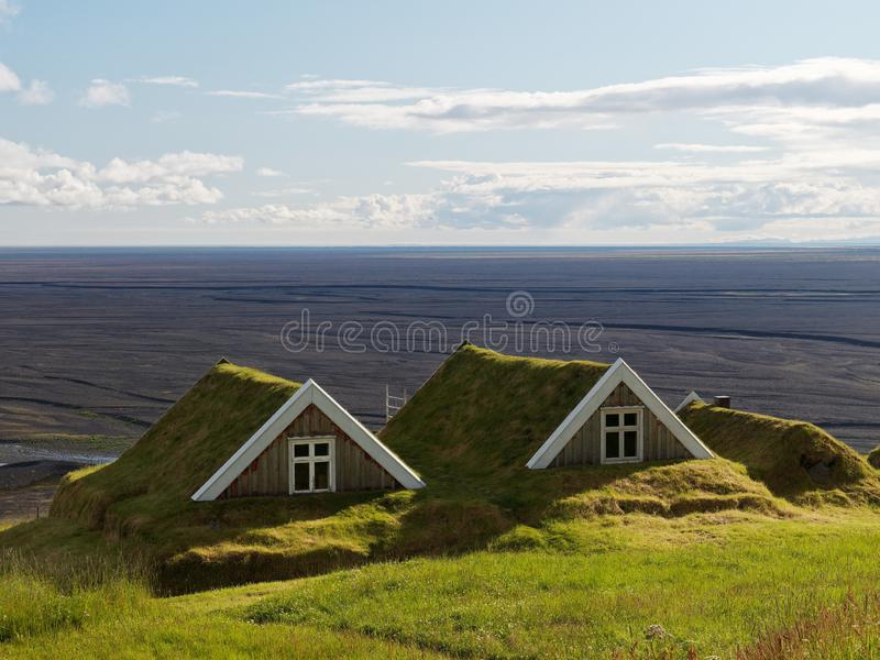 Two ancient cottages in iceland royalty free stock images