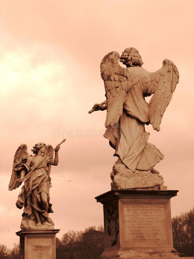 Two angel statues in sepia royalty free stock photography