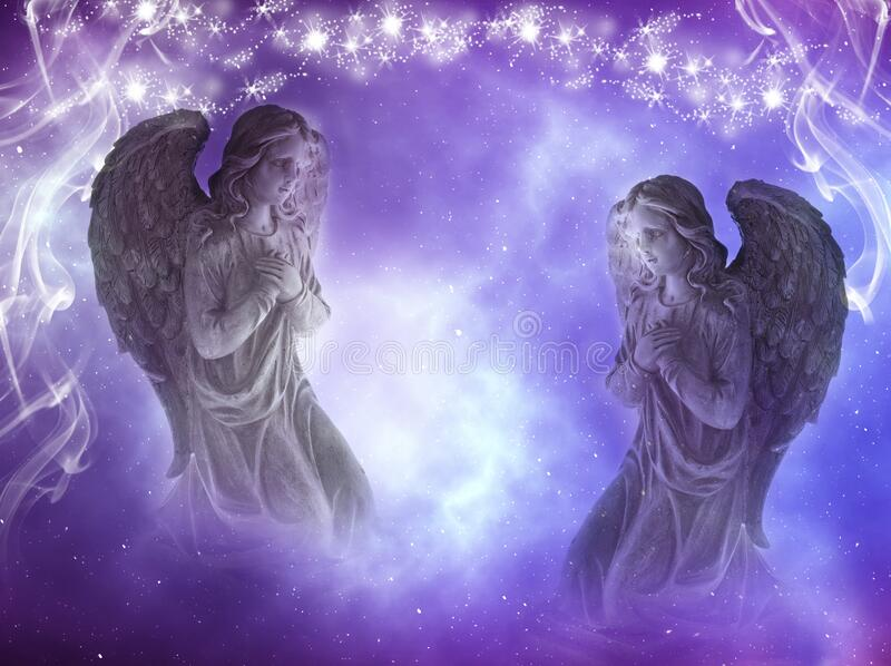 Two angels archangels with stars and divine mystic light royalty free stock photos
