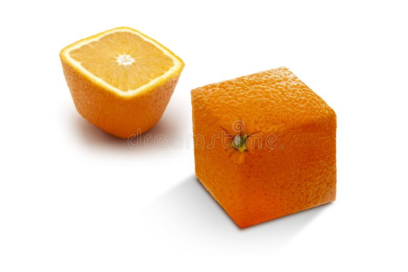 Two angled ripe oranges on a white background royalty free stock images