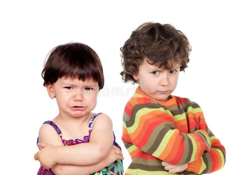 Two angry kids stock image