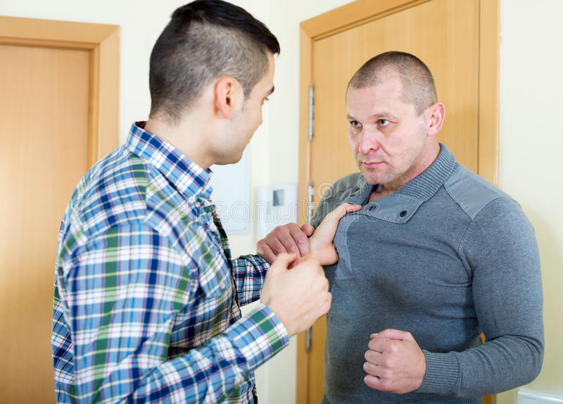 Two angry men royalty free stock photo