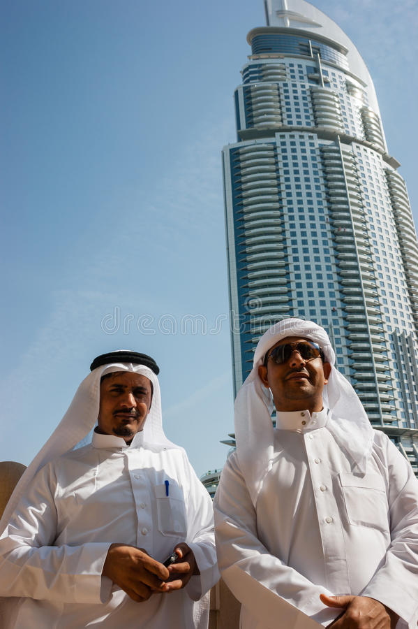 Two anonymous Arab men in traditional white clothing stock photo