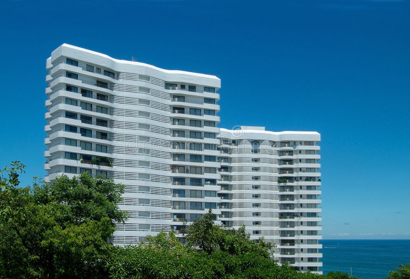 Two apartment-buildings by the sea royalty free stock images