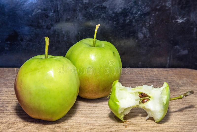 Two apples on a cutboard royalty free stock image