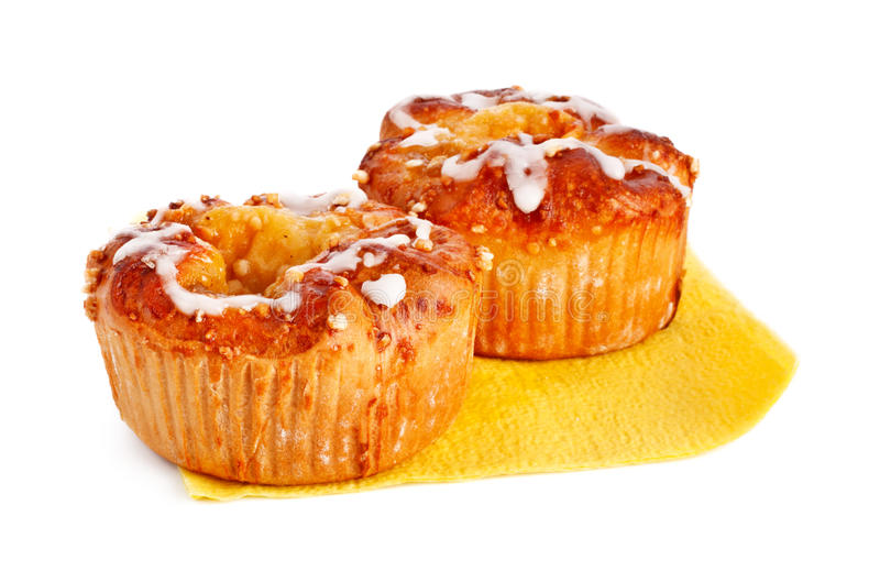Two apple cakes. On paper napkin isolated on white royalty free stock image