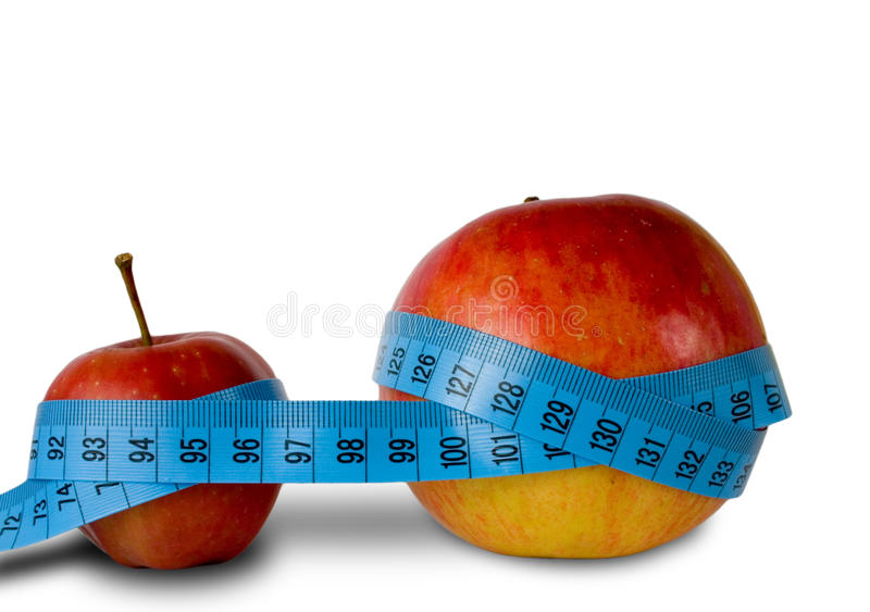 Two apple whit inch-tape. Two apple inch-tape whit background wo apple royalty free stock photo