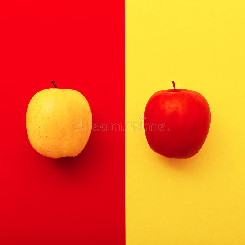 Two apples on bright backgrounds. geometry minimal style.  stock photography