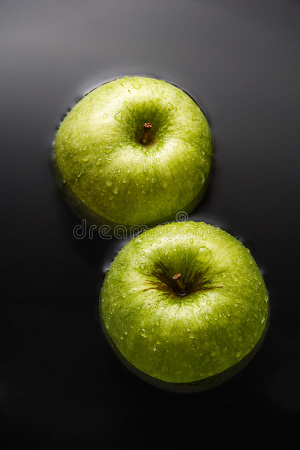 Two apples on water stock photography