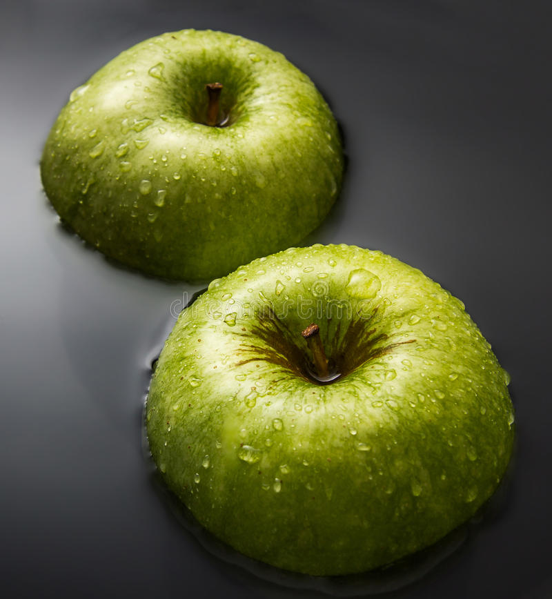 Two apples on water stock photo