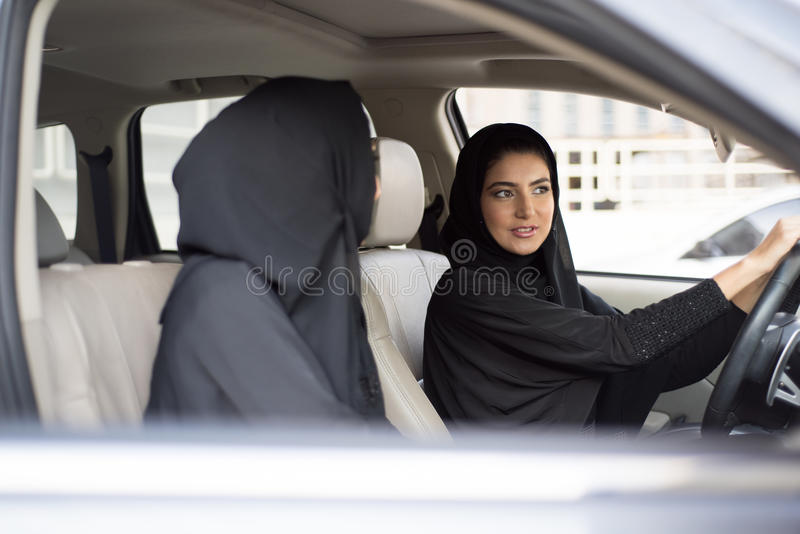 Two Arab Women Sitting in a Car, One is a Driver royalty free stock image
