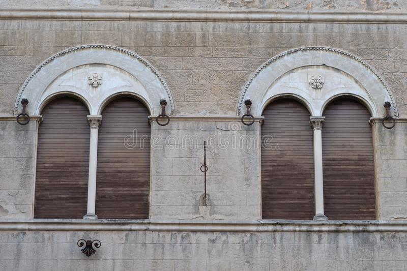 Two arched windows, Ascoli Piceno, Marche region, Italy stock images