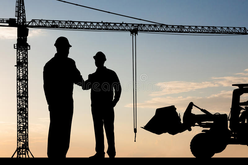 Two architect shaking hand royalty free stock photos