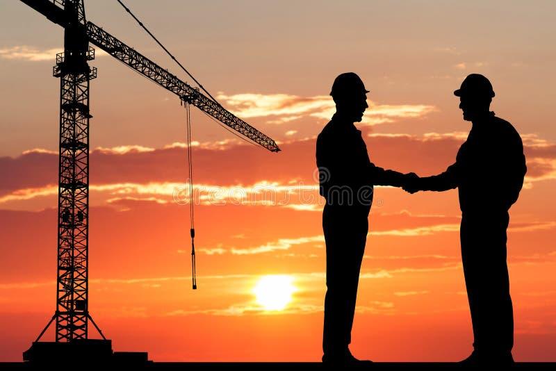 Two architect shaking hand royalty free stock photo
