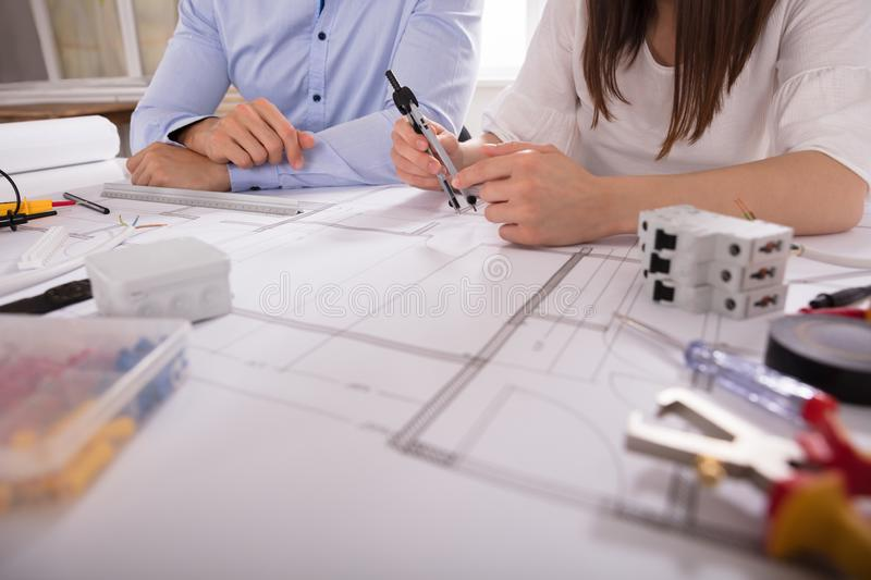 Two Architect Working With Work Tools royalty free stock photos