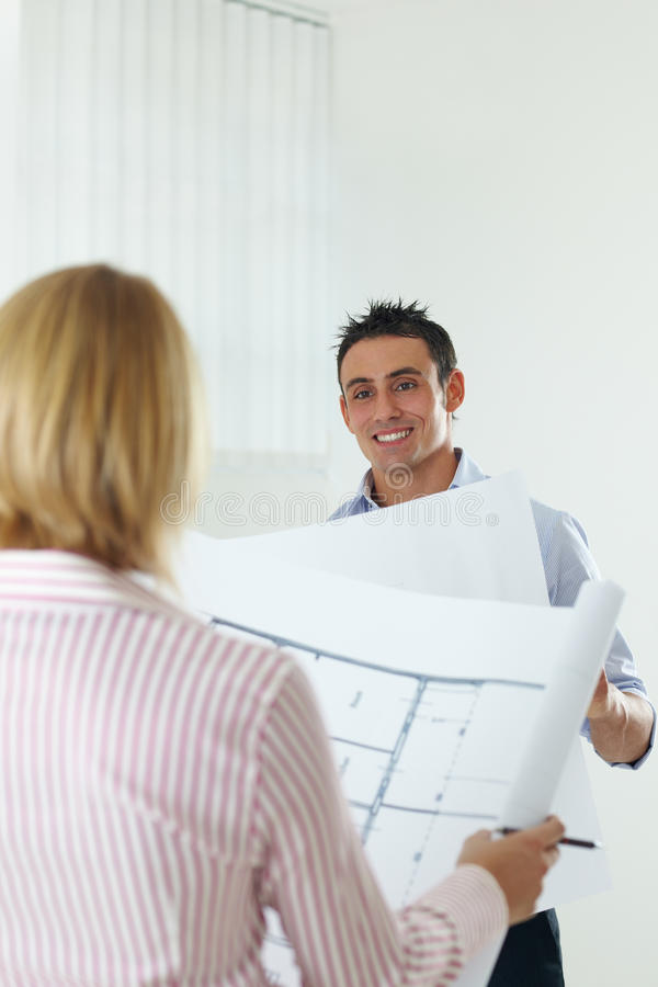 Download Two architects stock image. Image of couple, holding - 10046867