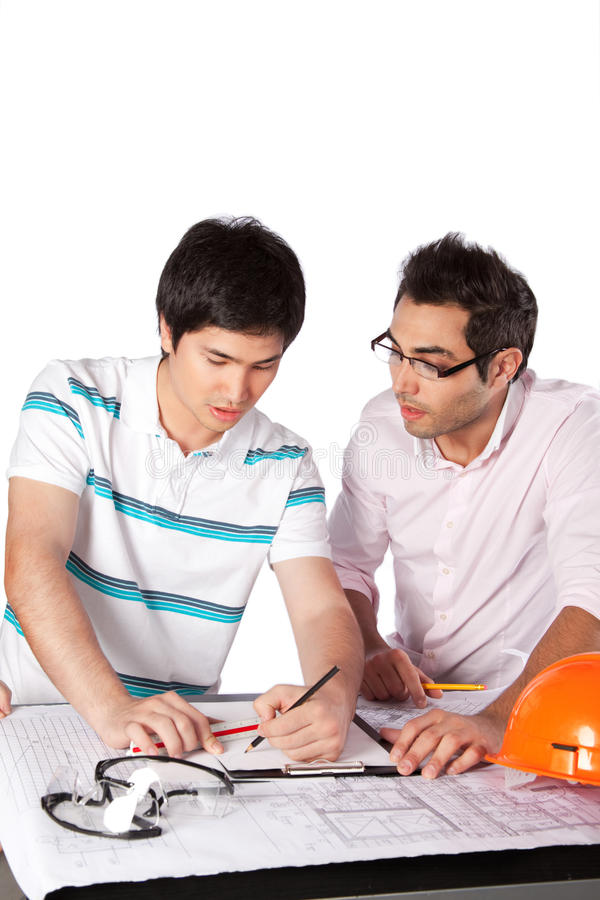 Two Architects Discussing on Blueprints stock image