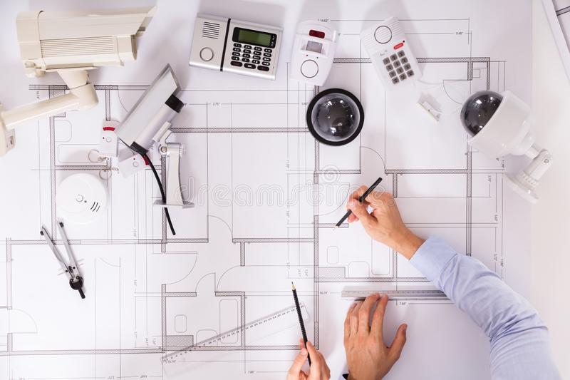 Two Architects Planning Project On Blueprint stock photos