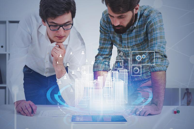 Two architects urban planning in office royalty free stock images