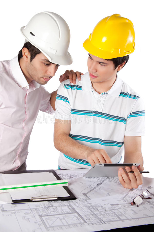 Two Architects Using Digital Tablet stock images