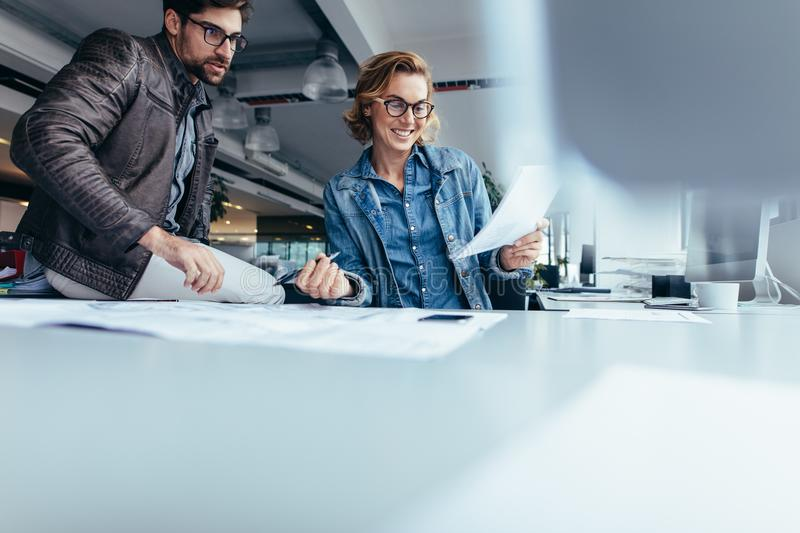 Happy business partners working together in office royalty free stock photos