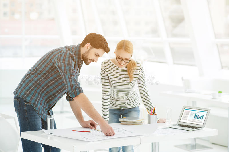 Two architects working together in office royalty free stock photography
