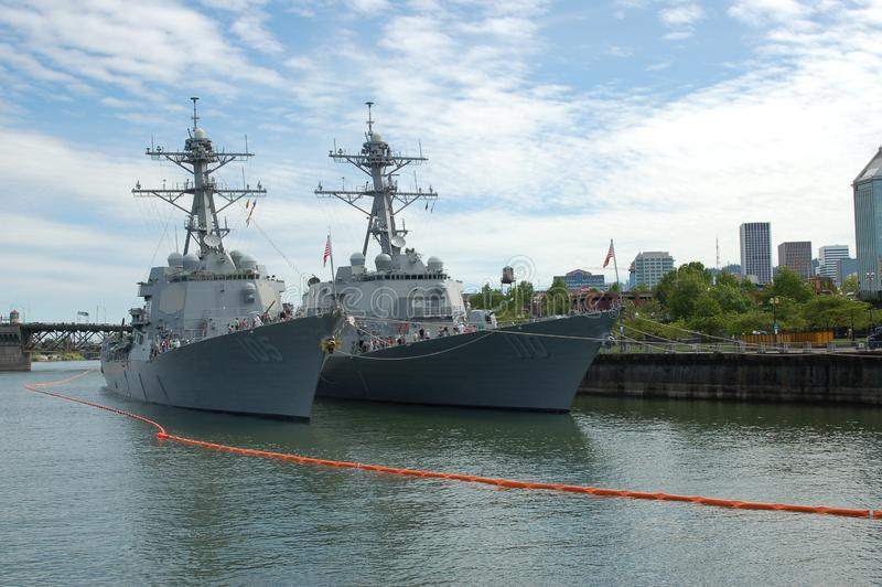 Two Arleigh Burke-class destroyers in Portland, OR. The Arleigh Burke-class destroyers USS Dewey DDG 105 and USS William P. Lawrence DDG 110 are moored on the royalty free stock photo