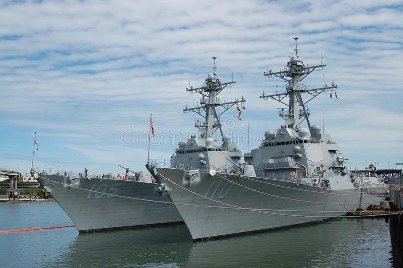 Two Arleigh Burke-class destroyers in Portland, OR. The Arleigh Burke-class destroyers USS Dewey DDG 105 and USS William P. Lawrence DDG 110 are moored on the royalty free stock photos