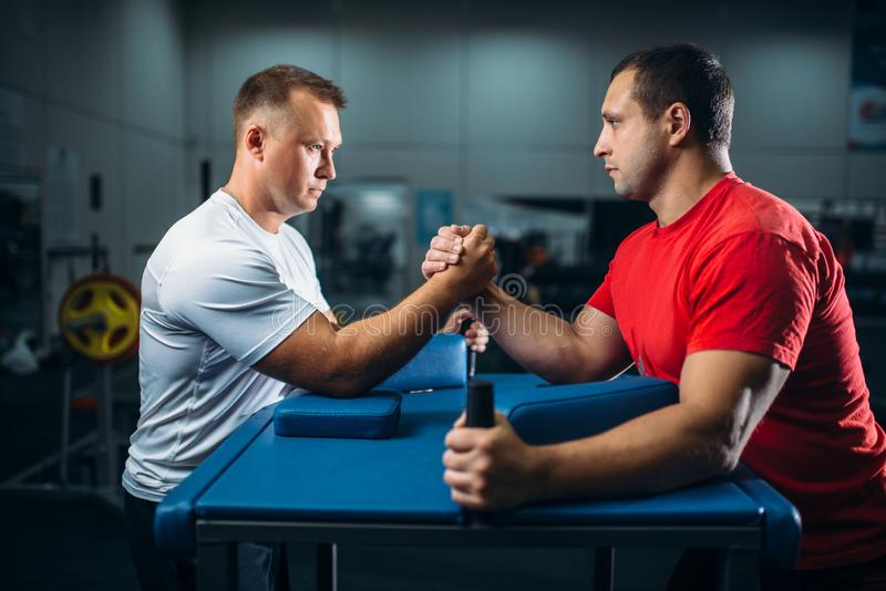 Two arm wrestlers on starting position, wrestling. Competition. Wrestle challenge, power sport royalty free stock photos