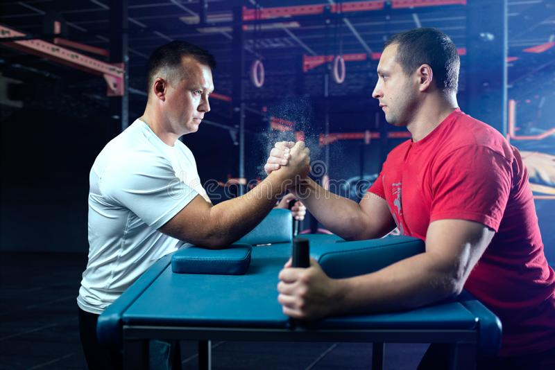 Two arm wrestlers on starting position, wrestling. Competition. Wrestle challenge, power sport stock photography