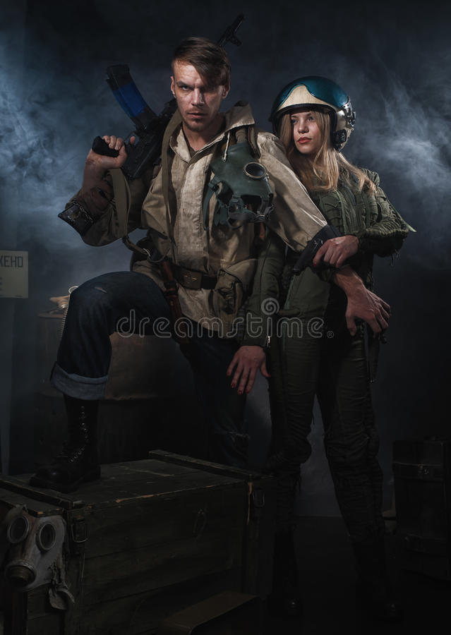 Two Armed man with a weapon. Two Armed men with a weapon. Post-apocalyptic fiction. Stalker royalty free stock photos