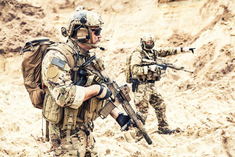 Special operations forces team raiding in desert royalty free stock photo