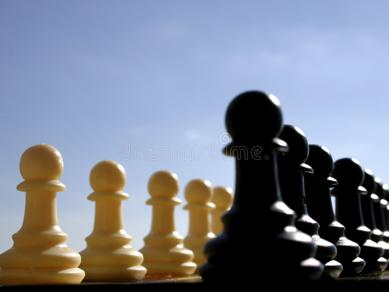 Two armies. Two pawns armies ready for the war stock photo