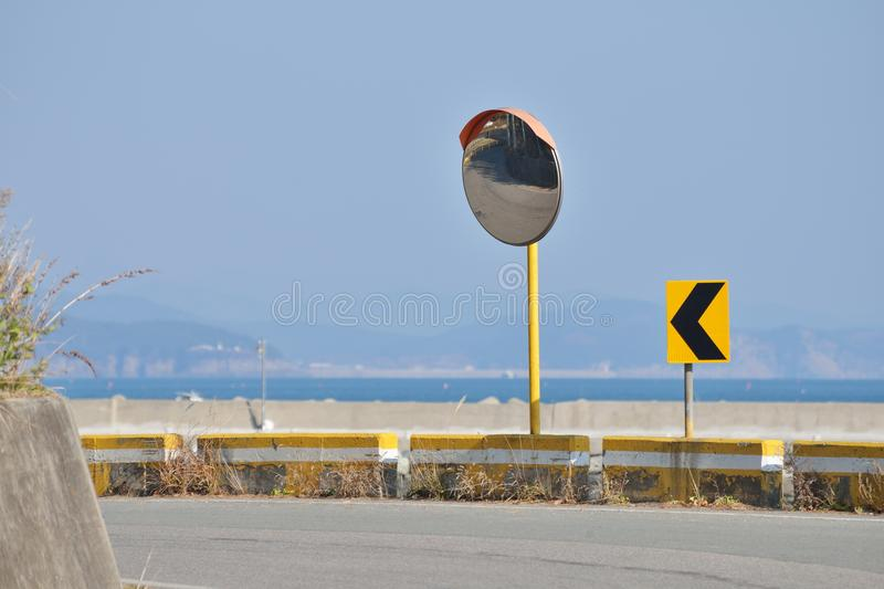 Two Arrow Curve Sign and Convex Mirror royalty free stock images