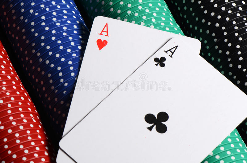 Two ases and casino chips royalty free stock image