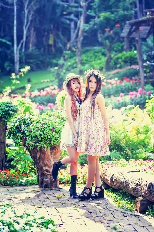 Two asia young women in the garden royalty free stock photos