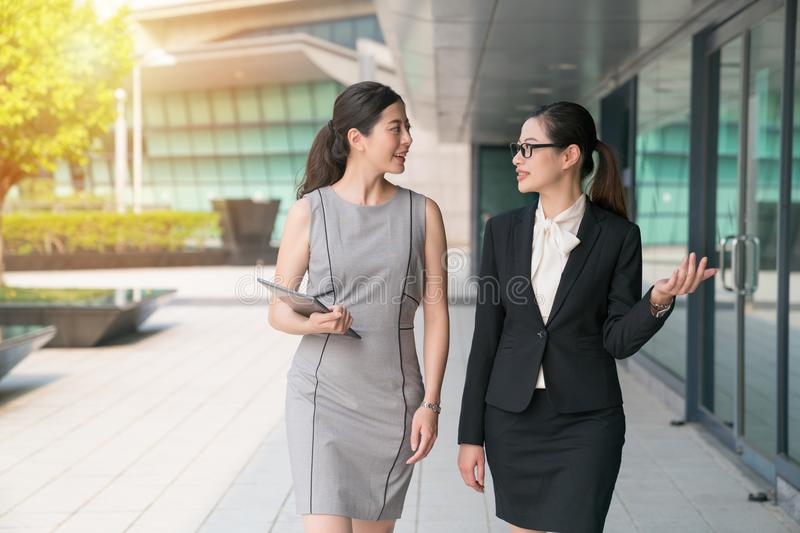 Office lady walk side by side. royalty free stock photography