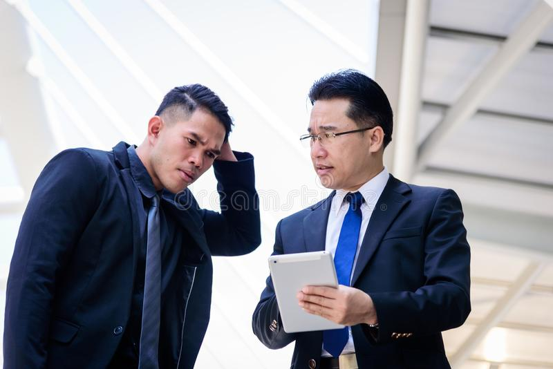 Two asian businessman has talking for business vision. royalty free stock photography